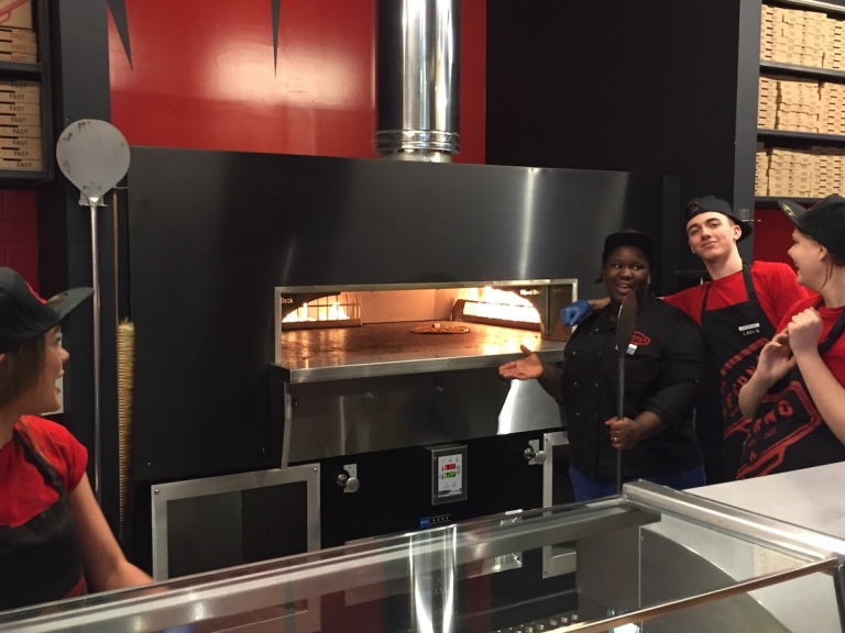 A team thats proud of it's 900 degree oven at Inferno Pizza Nottingham